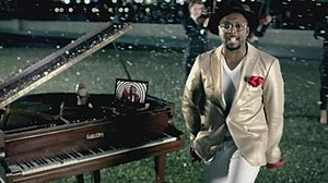 This Is Love (will.i.am song) - will.i.am and his grand piano on the South Bank accompanied by a laptop, displaying shots of the night club.