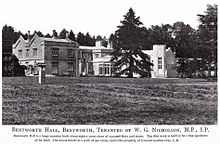 The south side of Bentworth Hall as it appeared in 1905. The black and white photo shows a large fir tree, the gardens and the manor itself