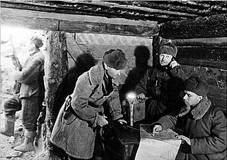 284th Rifle Division (Soviet Union) - Col. N.F. Batyuk (holding the phone) in his headquarters with members of his staff