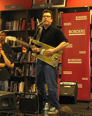 John Flansburgh performing in a Borders store ...