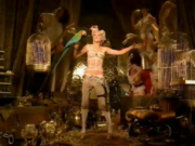 Gwen Stefani, flanked by her Harajuku Girls, dancing in the treasure trove from the music video.