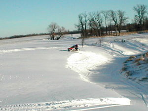 Spring Creek being used for snowmobile recreat...