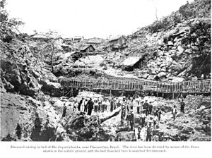 Diamantina, Minas Gerais - Mining for diamonds near Diamantina. River has been diverted by means of the flume shown in the middle ground, and the dried bed is searched for diamonds