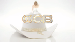 A large white hat with gold trim.