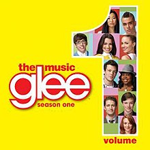 "Photographs of ten people on a multicoloured background fill in a large Arabic numeral ""1"" to the right. On a yellow background, the word ""Glee"" is in lowercase white to the centre left, with the words ""The Music"" above and ""Season One"" below in lowercase red font. The word ""Volume"" also appears beside the 1."