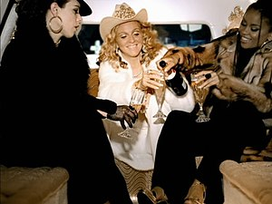 Music (Madonna song) - Madonna (center), her then background singer Niki Haris (right), and actress Debi Mazar (left) in the video.