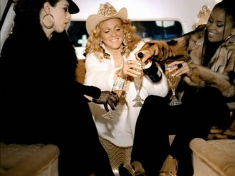 Music (Madonna song) - Madonna (center) with Niki Haris (right) and actress Debi Mazar (left) in the music video.