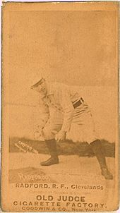 A picture depicting a baseball player who is holding a ball with his right hand, and is crouched as if he is ready to throw it