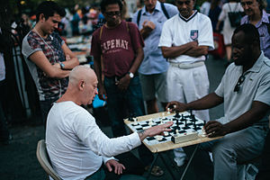Fast chess - Spectators watch as a street chess player plays bullet chess with  Jonathan Corbblah in Union Square, Manhattan.