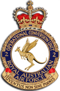 "Crest of 2 Operational Conversion Unit, Royal Australian Air Force, featuring a winged kangaroo and the motto ""Juventus Non Sine Pinnis"""
