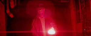 "Lighters (song) - Royce da 5'9"" rapping in an underground system tunnel illuminated by red highway flares."
