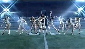Broken Heels - Burke and her female backing dancers dressed in gold leotards with football-style shoulder pads and heeled shoes, perform the outdoor dance sequence of the video. The scenes are intercut with shots of the group changing and Burke in a green-lit tunnel.