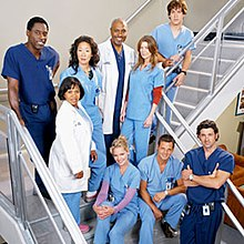 A photo of the Grey's Anatomy characters in surgical scrubs