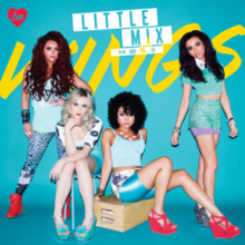 "Little Mix pose in front of a blue background with ""Wings"" written in yellow."