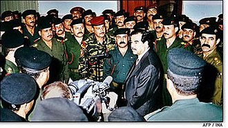 Republican Guard (Iraq) - Then-Iraqi President Saddam Hussein talks with Republican Guard officers in Baghdad on March 1, 2003. Iraqi News Agency/AP.