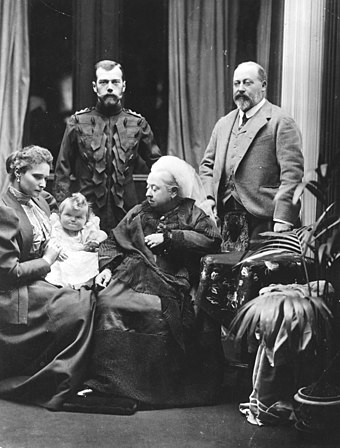 Edward (right) with his mother (centre) and Russian relations: Tsar Nicholas II (left), Empress Alexandra and baby Grand Duchess Olga Nikolaevna, 1896 Royal family group 1896.jpg