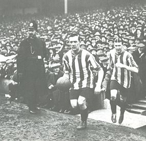 Captain George Utley leads Sheffield United out for the 1915 FA Cup final. ShefU1915.jpg