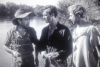 "The Southerner (film) - Left to right: Henry Devers (Naish), Sam Tucker (Scott), and Finlay (Lloyd) after Sam catches ""Lead Pencil"""