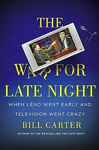 A blue book cover with its title written in yellow lettering. A television showing Conan O'Brien pointing a finger at Jay Leno is squeezed between the title's words in the center.