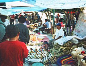 Chilapa de Álvarez - Vendors selling woven goods in the tianguis of Chilapa
