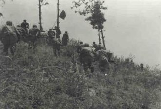 Battle of Kapyong - Chinese forces pursuing South Korean troops near Kapyong.