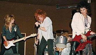 Hollywood Rose - Hollywood Rose playing Madame Wong's East on June 28, 1984. From left to right, bassist Steve Darrow, singer Axl Rose, drummer Steven Adler, guitarist Slash