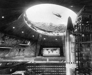 SPECTRE - Blofeld's SPECTRE volcano base complete with spacecraft-swallowing Bird One spacecraft, helipad and attack helicopter, and command centre in the 1967 film You Only Live Twice. The world map in the background is common to emphasise the aim of world domination.