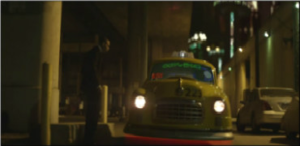 Turn Up the Music (Chris Brown song) - A screenshot of Brown (pictured) hailing a futuristic hover-cab in the music video.