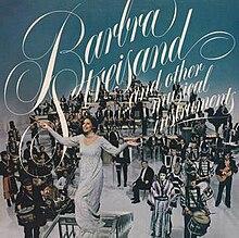 Barbra Streisand verschijnt voor een heel orkest en andere muzikanten bovenop een blauwe achtergrond met de titel van het album.