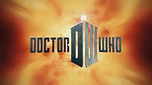"In front of a fiery background, steely gray block letters spell out ""DOCTOR WHO"". In between the two words is a large D and W which are angeled together to form a box; atop of the structure is a bright lamp light."