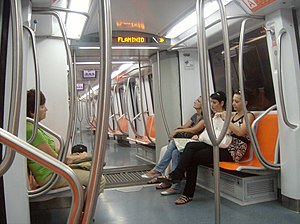 Line A (Rome Metro) - Interior of an S/300 train. The chevrons on the LED displays indicate that the doors will open on the right side of the train at Flaminio - Piazza del Popolo.