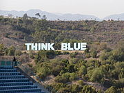 Think Blue sign in the mountains north of Dodger Stadium.