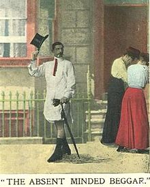 Man in a shirt and tie, with a fancy cane but no trousers tips his top hat.