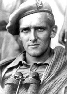 picture of soldier wearing beret and binoculars slung around neck