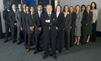 The Apprentice (UK series 2) - Promo group shot of Alan Sugar standing before the candidates for series 2