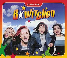 "Image shows B*Witched dancing around a lush green field on a beautiful sunny day. The words ""B*Witched"" and ""C'est La Vie"" are written on the picture. There is also an orange and yellow gradient border around the photo with green, red, yellow and orange stars at the bottom of the image."