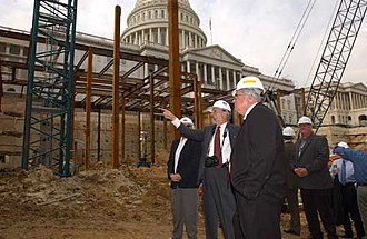 Former House Speaker Dennis Hastert and former Architect of the Capitol Alan Hantman tour the CVC during the early stages of construction. CapitolVisitorsCenter2.jpg