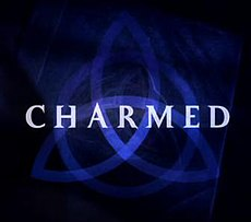 A dark blue triquetra over a darker blue background that fades to black near the edges with the word charmed in capital letters across the center using a light-blue, medium-sized font