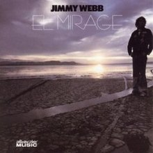 Album cover image of Jimmy Webb in silhouette on a beach at sunset