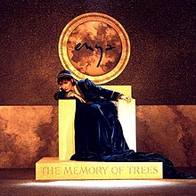 Album cover: Enya, dressed in a very long, dark gown and matching cap, sits on a stone throne. Her body leans to the right; her chin rests on a folded arm on the armrest as she glances at the viewer. Her name appears on a circular wall decoration above the throne; the album title is engraved on the dais beneath her feet.