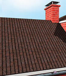A pixelated image of a brown gable roof with a red brick fireplace; in the gutter is a discarded purple condom wrapper.