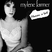 Photo depicting at the left Mylène Farmer who is wearing a white nightgown, on a black background