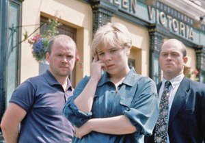 Sharongate - Sharon's affair with Phil (left) is discovered by Grant (right), a storyline dubbed Sharongate (1994)