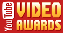 "The words ""YouTube VIDEO AWARDS"" written against a red background. ""YouTube"" is written vertically against the left-hand side of the image. ""You"" is written in a white font""; ""Tube"" is written in a red font within a white, rounded rectangle. ""VIDEO AWARDS"" is written in a yellow-white font. The middle of the D in ""VIDEO"" is a right-pointing triangle, like a ""Play"" logo."
