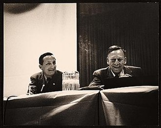 Gregory Bateson - Rudolph Arnheim (L) and Bateson (R) speaking at the American Federation of Arts 48th Annual Convention, 1957 Apr 6 / Eliot Elisofon, photographer. American Federation of Arts records, Archives of American Art, Smithsonian Institution.
