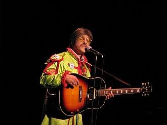 The Cast of Beatlemania - Carlo Cantamessa as John Lennon