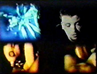 Frank's Cock - A scene from the film, depicting the use of each quadrant; the split screen effect has been described as evoking the physical effects of AIDS.