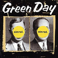 Two black and white pictures of men in suits and ties are placed side by side with a beige-colored outline atop a black background The mens faces are obscured by two yellow circles inscribed with the phrase nimrod At the top of the image Green Day is written in white lettering