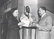 Jean Blackwell Hutson and Langston Hughes pictured at the Schomburg Collection with Pietro Calvi's bust of Ira Aldridge as Othello,  1948. Photograph courtesy of Arthur Schomberg Center for Research in Black Culture