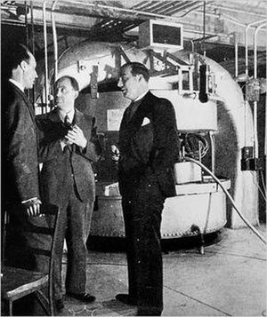 John R. Dunning - The cyclotron built by Dunning in 1939, in the Pupin Hall physics building basement at Columbia University. Dunning (left) is with  Enrico Fermi (center) and Dana P. Mitchell (right)